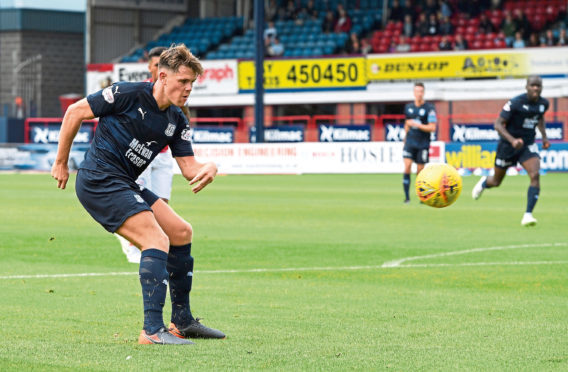 Dundee's Lewis Spence scores against Brechin last month