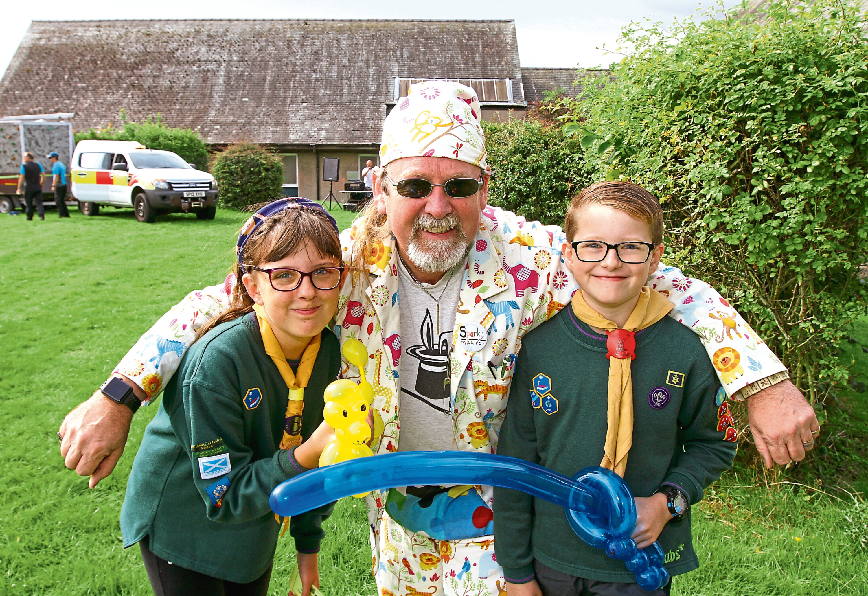Sparky the Balloon Man with 10-year-olds Hannah White and Ruaridh Findlay at Fintry Gala Day