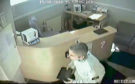 CCTV pictures show the thief making off with the tablet from the dental practice.