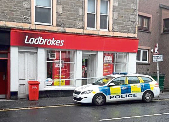 Police outside Ladbrokes in Perth Road after the alleged incident