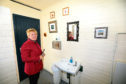 Trustee Wendy Murray inside the public convenience.