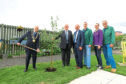 Lord Provost Ian Borthwick planting a tree at the official opening of the Dundee Therapy Garden, in Dudhope Park in Dundee last year.