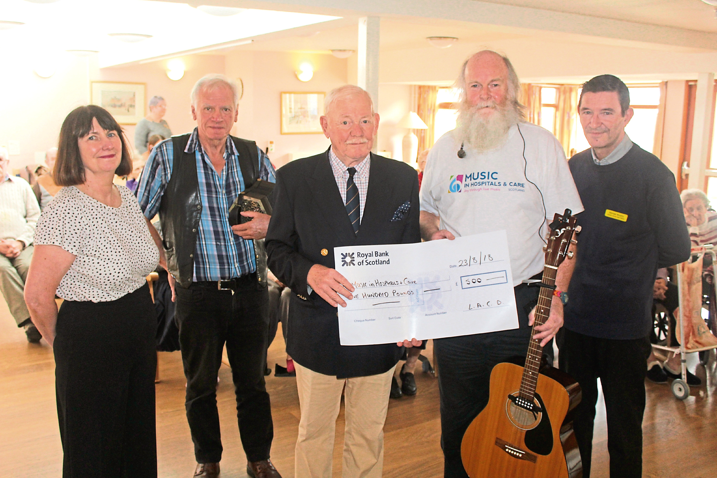 Pictured are Angela Doran (music development officer), Davie McMartin (from band On the Wagon), Sinclair Aitken (chairman of Leisure and Culture Dundee), Derek Richardson (Music in Hospitals & Care) and Michael Murphy (activity social care officer).