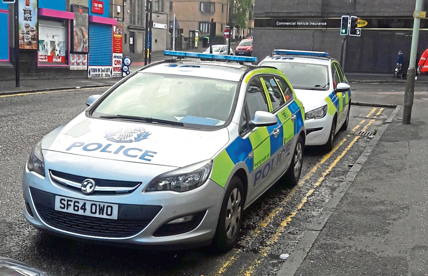 Police vehicles on Main Street