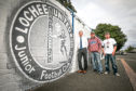 Artist Symon Mathieson, centre, with Marc Stanton, Lochee United secretary and Myles McCallum, treasurer VOLCP