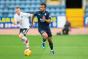 Adil Nabi of Dundee races away from Andy Geggan of Ayr United