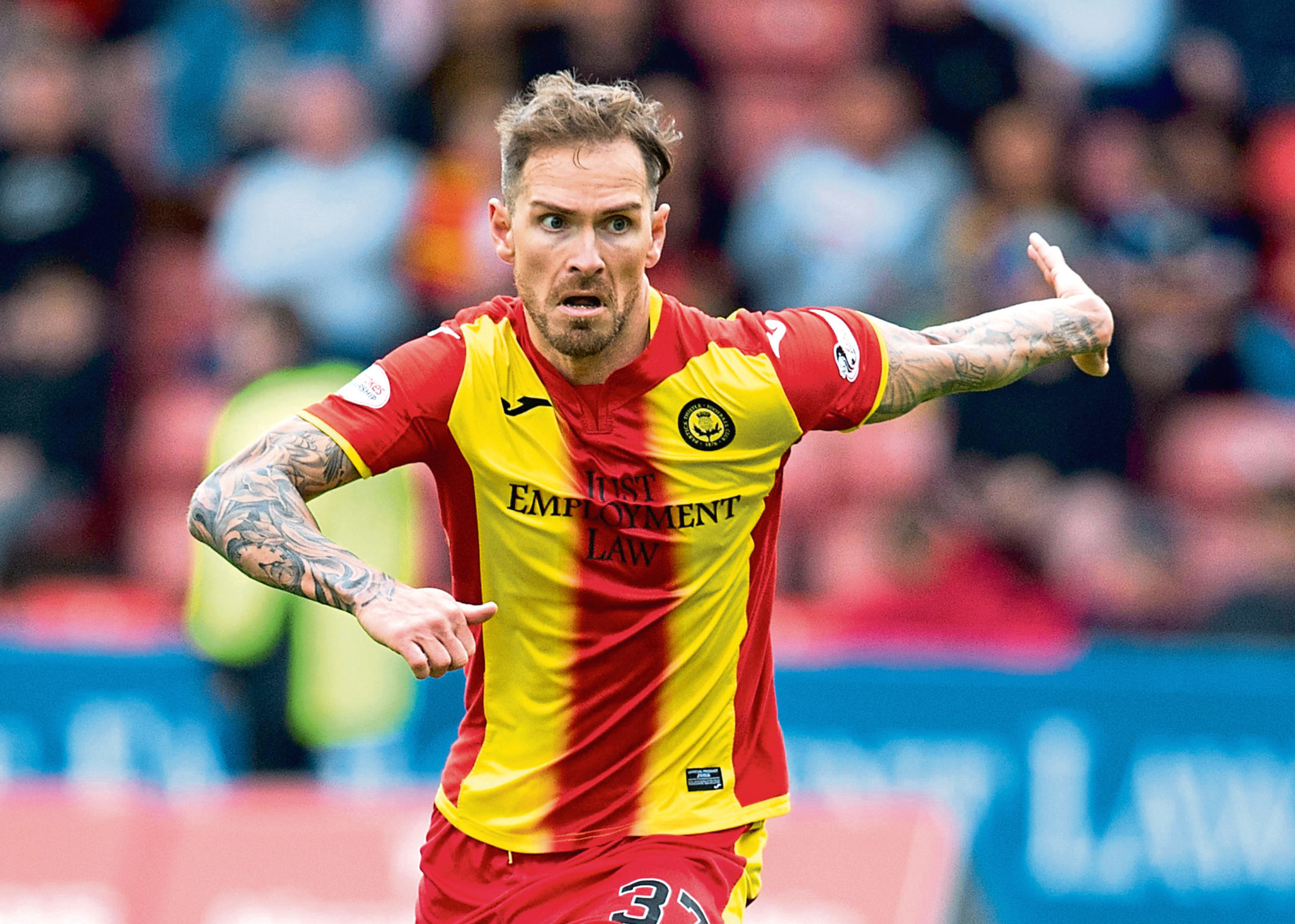 Former Ross County and Partick Thistle midfielder Martin Woods has been on trial at Dundee United over the past few days.