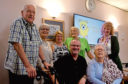 Staff and residents at Bield Housing and Care on Strathmartine Road, who appear in a film about childhood teddies