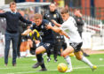 Dundee's Benjamin Kallman (left) is challenged by Ayr's Michael Rose