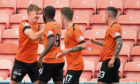 Dundee United's Paul Watson (left) celebrates his opening goal with his teammates