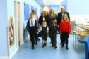 Front, from left, pupils Misia Przeworowska, Oscar Adams, Wesley Azubuike-Oyoyo and Sian Fairfield, with, back, Roisin Smith, deputy convenor of children and families services, Ali Curran, Jennifer Heffell and Paul Clancy, executive director of  children and families services