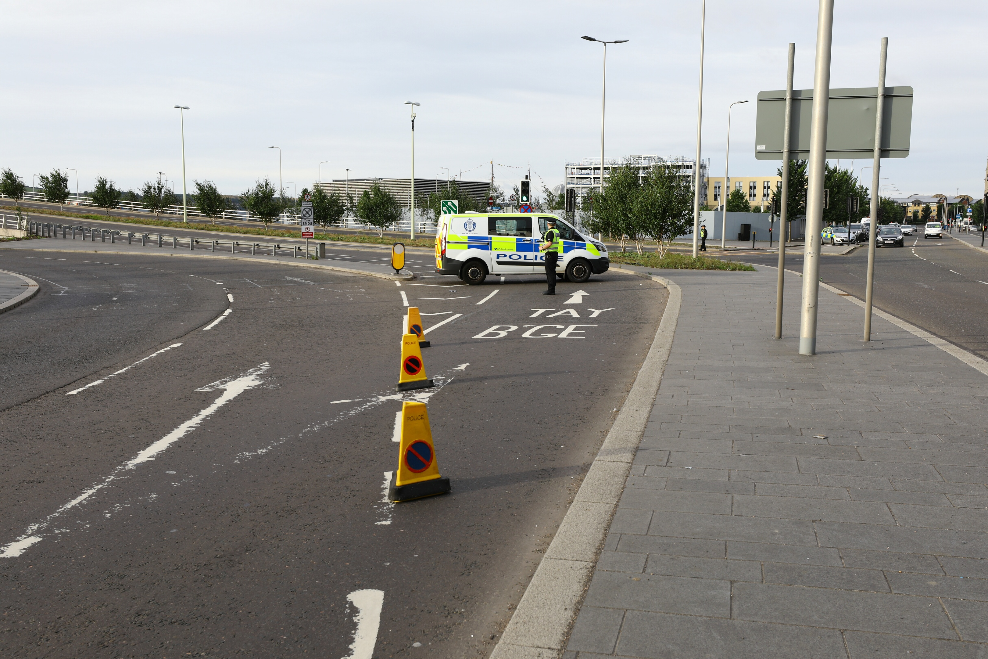 A police officer blocks the entrance ramp to the road bridge during the incident.