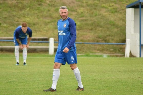 Kevin McNaughton in action for Lochee United