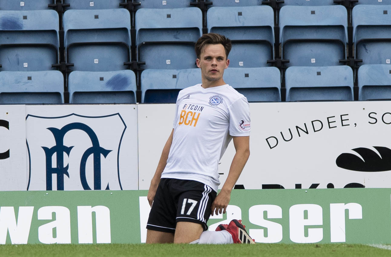 Ayr's Lawrence Shankland celebrates after scoring against Dundee in the Betfred Cup.