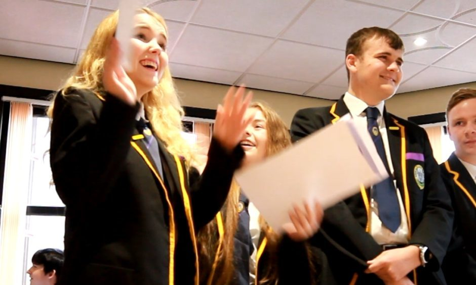 Taylor Williams opens her exam results
