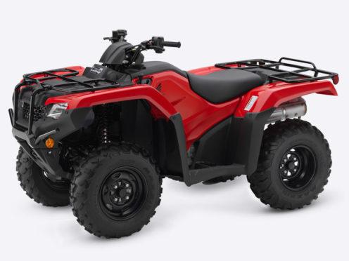 A red Honda qudbike