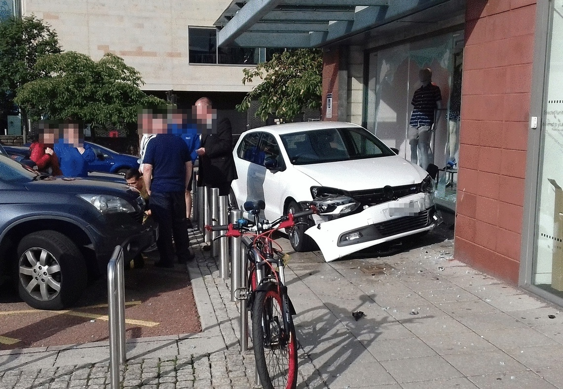 The vehicle crashed through the window of the Next store in the Gallagher Retail Park