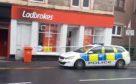 Police outside Ladbrokes on Sunday.