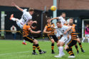 Dundee United's Paul Watson scores the opener against Alloa.