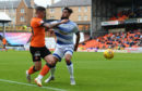 Greenock Morton's Rory McKeown competes with Dundee United's Fraser Aird.