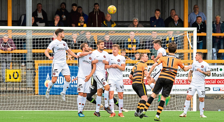 Alloa's Iain Flannigan (No 11) scored a delightful, dipping free-kick to make it 1-1
