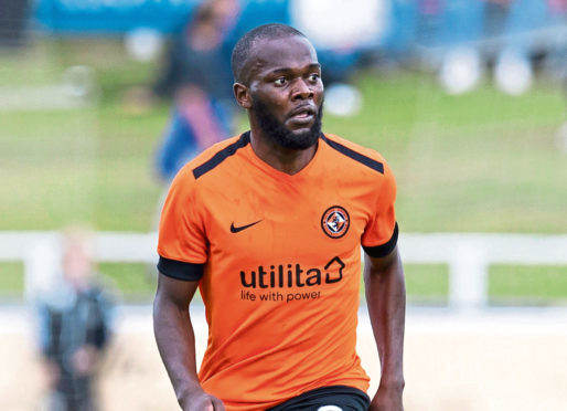Yannick Loemba in action for Dundee United.