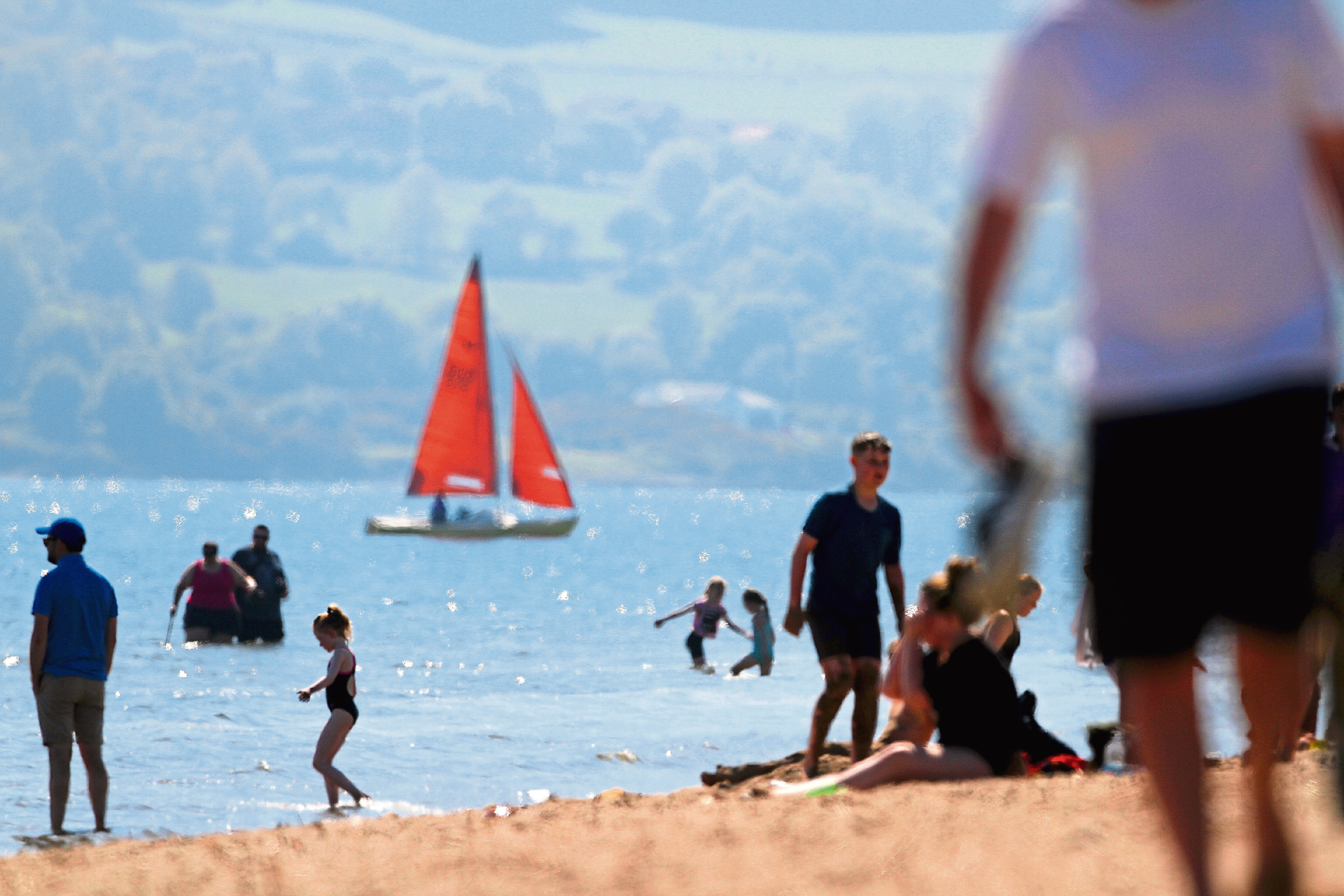 People cooling off by the River Tay on Broughty Ferry beach