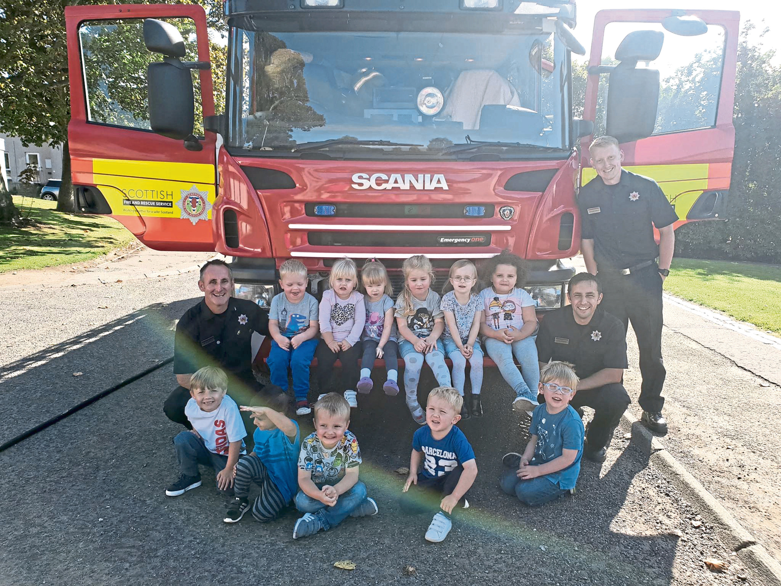 The Ninewells Nursery kids with the firefighters