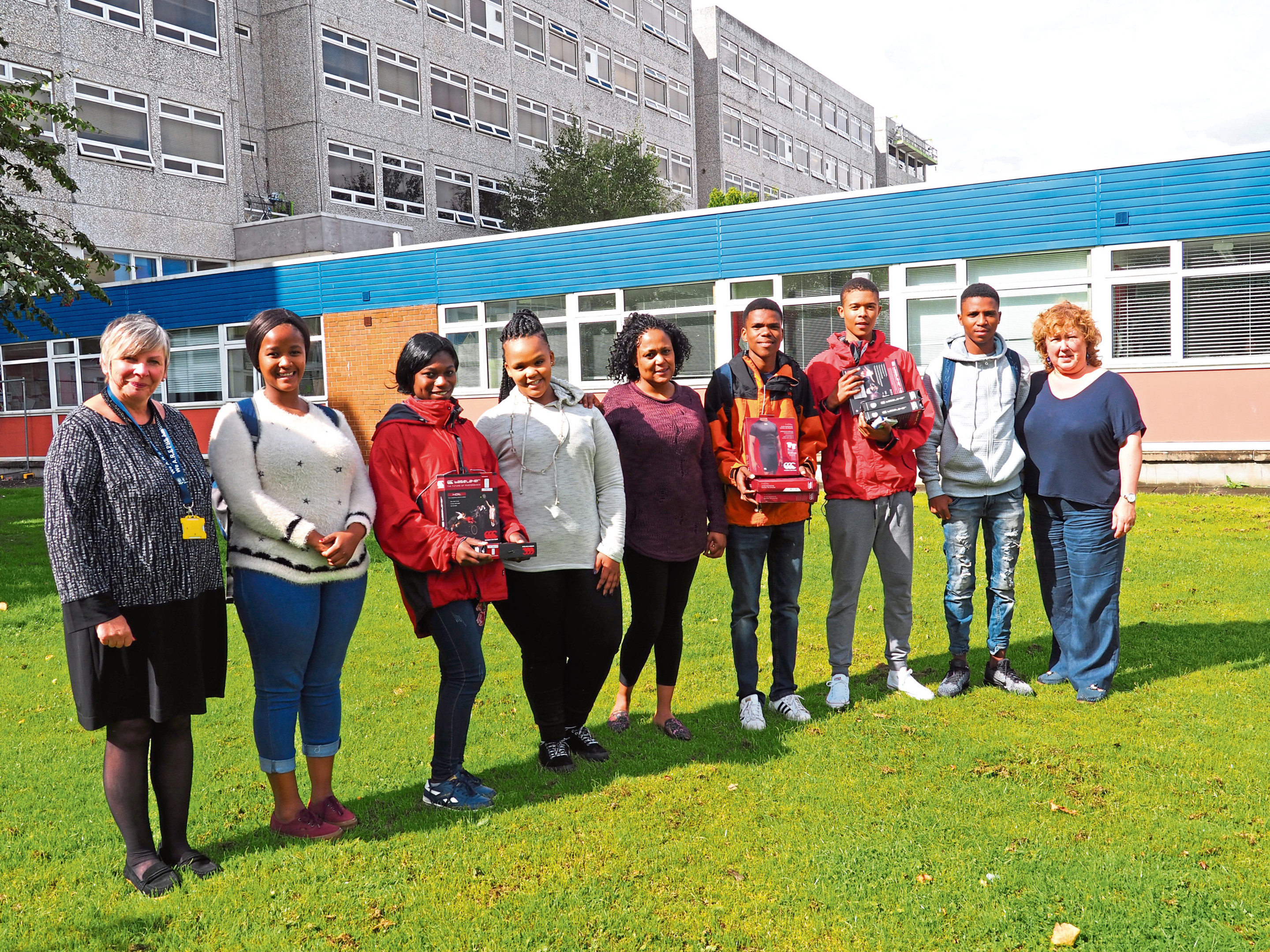 Pictured with the Bongani pupils are Perth High head teacher Thirza Pupillo (left) and Margo.