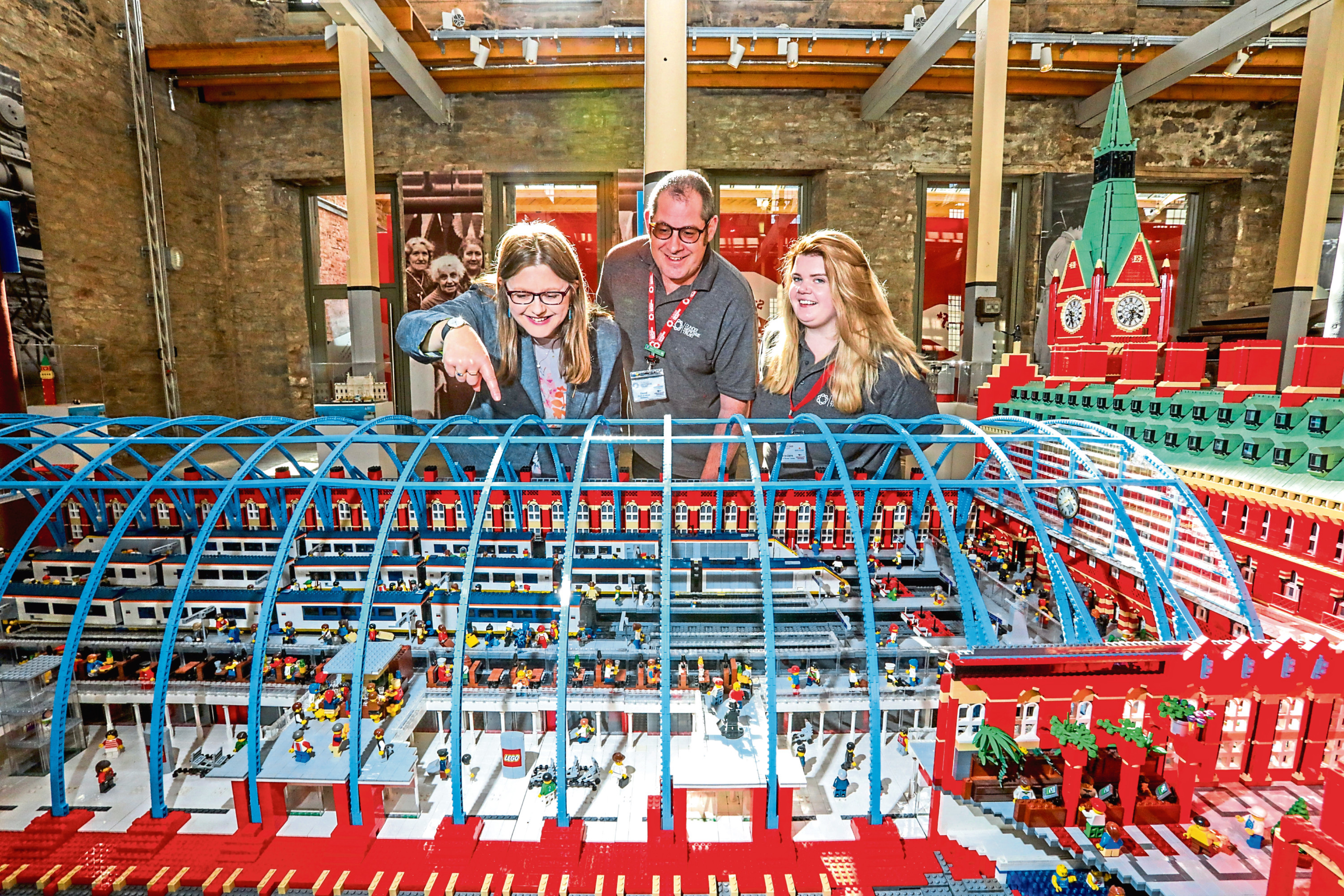 Picture shows, from left, Gill Poulter (heritage director of Dundee Heritage Trust) alongside David Reid and Marieclaire White (both Dundee Heritage Trust / Verdant Works), admiring the model of St Pancras station