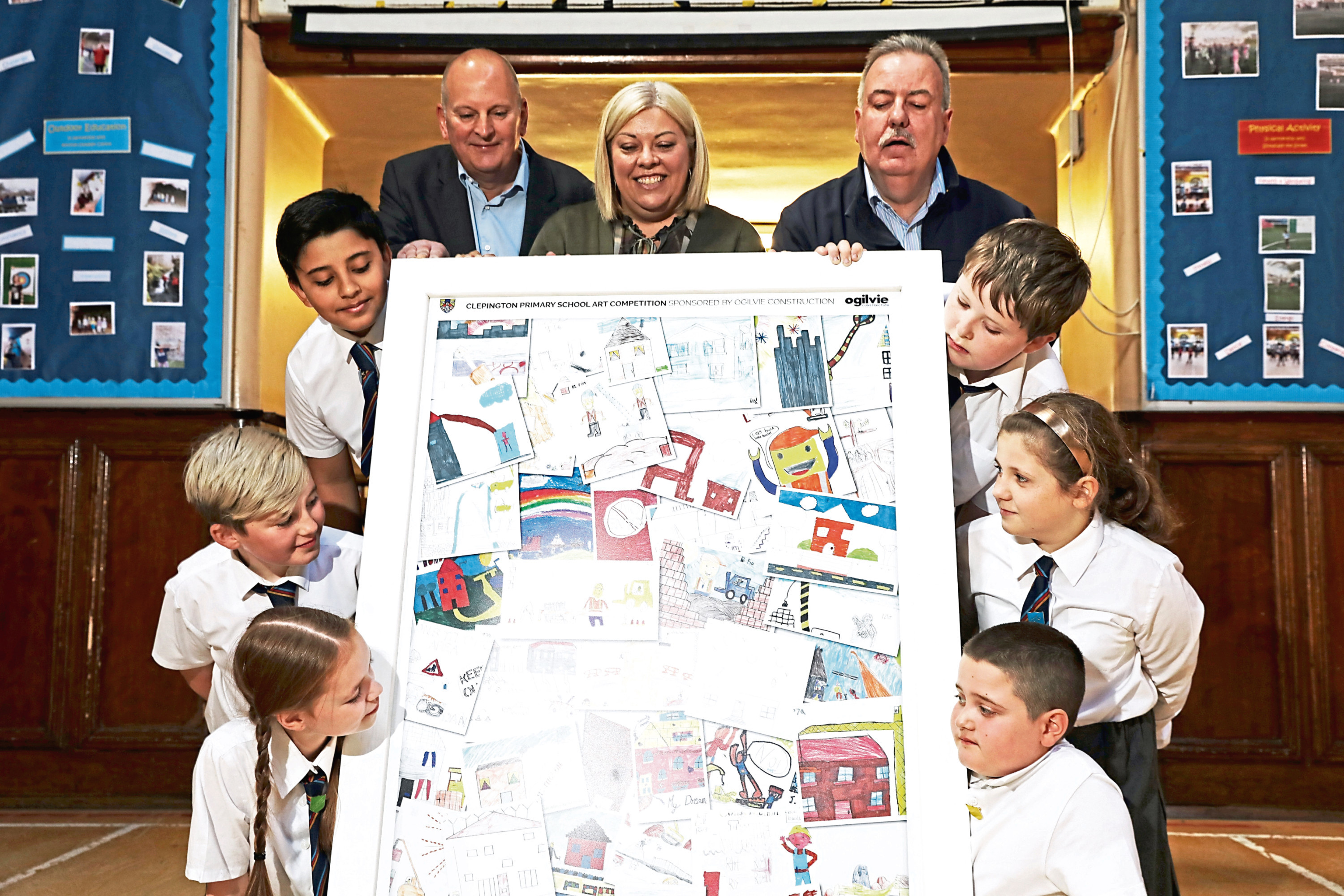 Picture shows, from left, Ms Cheghall with Hillcrest development director David Zwirlein (left) and Mr Bell, with some of the pupils and their designs