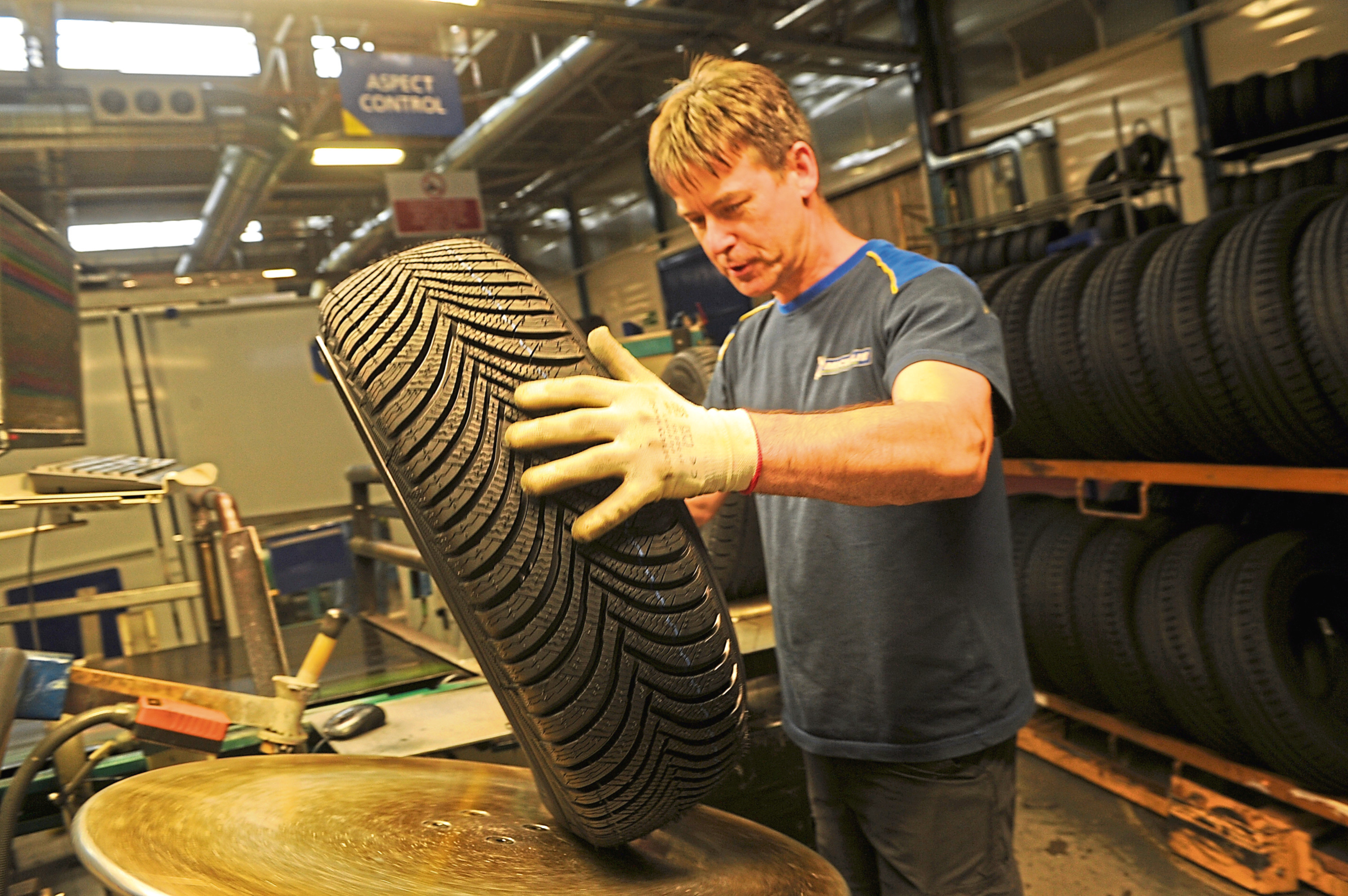 Verification worker Pat Hughes inspects a tyre at the Michelin plant in Baldovie Road, Dundee.