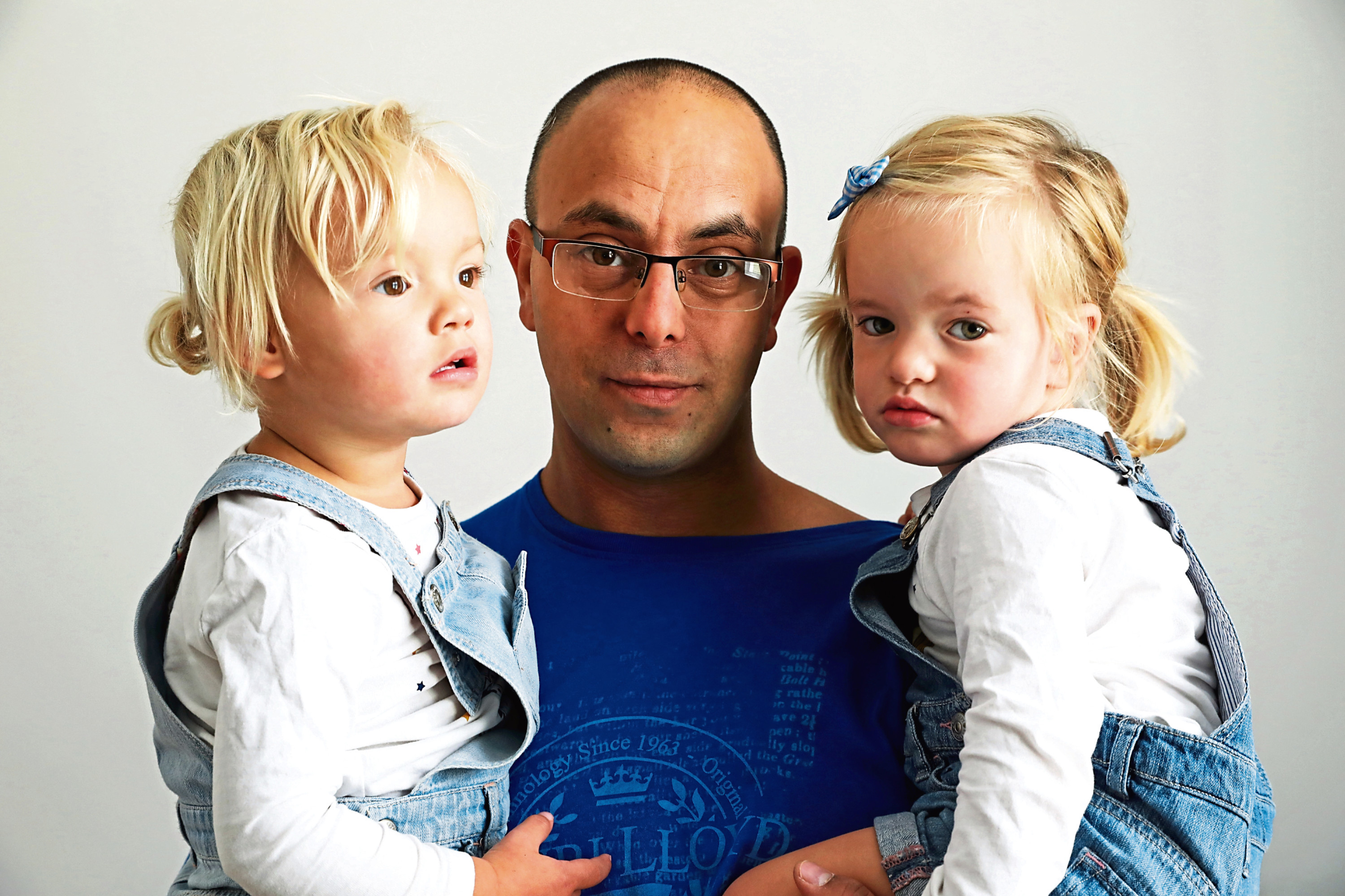 Tarig Brady with twins Erica and Evie