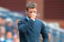 Neil McCann watches on as his side were beaten heavily at Ibrox.