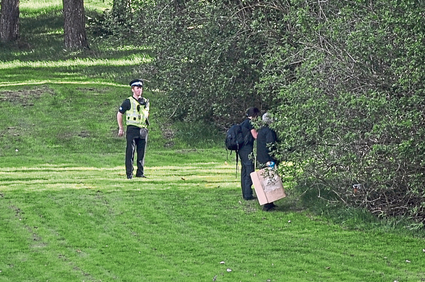 Forensic officers investigate the scene of the crime at Caird Park Golf Club, Dundee