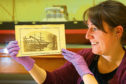 Julie McCombie,  social history curator, with a photo of 'The Artic from Erik's Bridge' from the recognised whaling collection, at The McManus Collections Unit in Dundee
