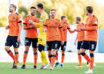 Dundee United attacker Craig Curran (centre) celebrates their vital 2-0 win at Falkirk on Saturday with his team-mates at full-time