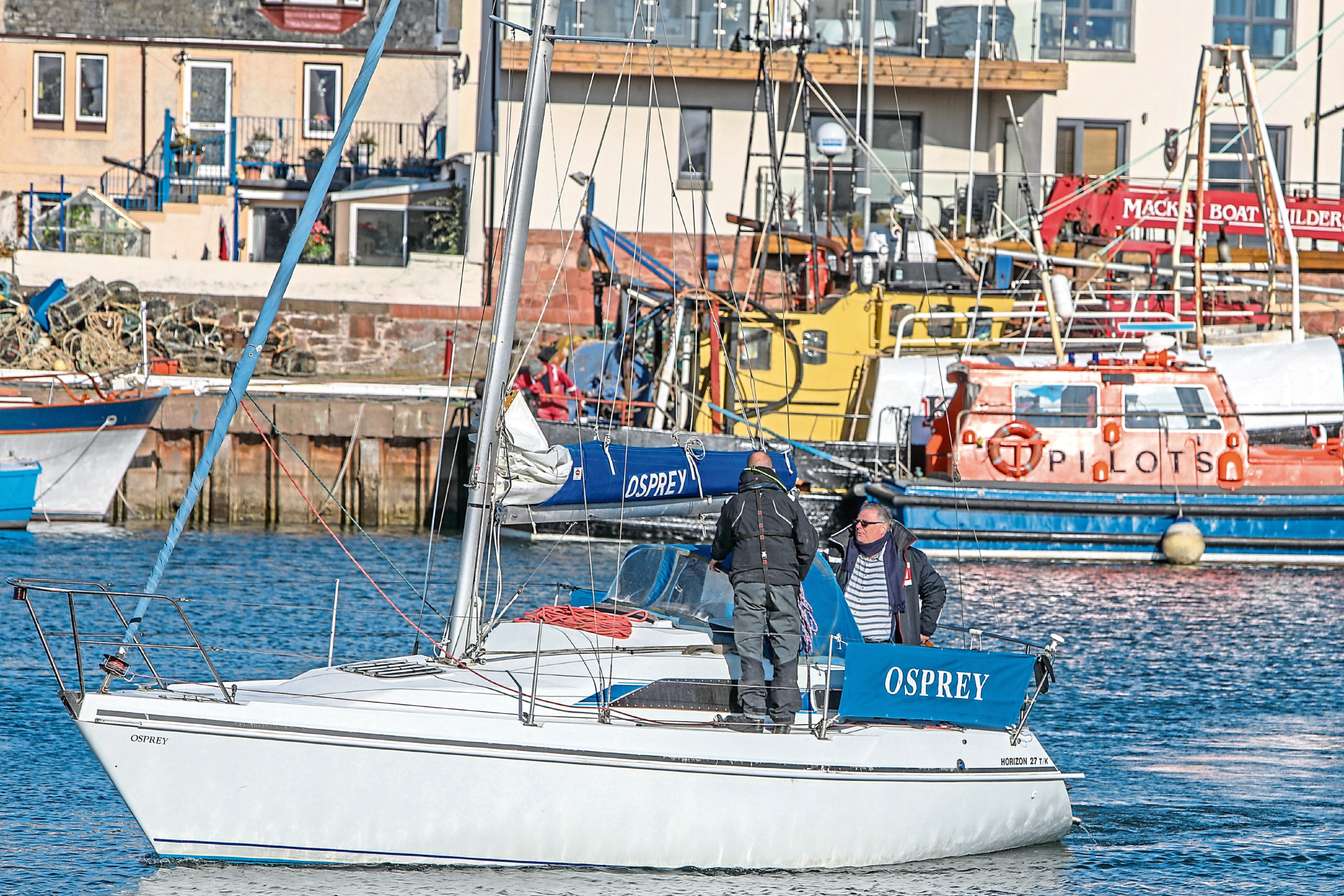 The yacht's owner brings the boat back in to Arbroath Harbour.