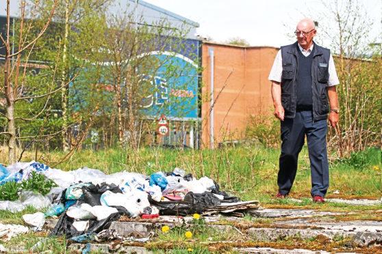 John McNaughton near rubbish piled up outside Dundee Ice Arena