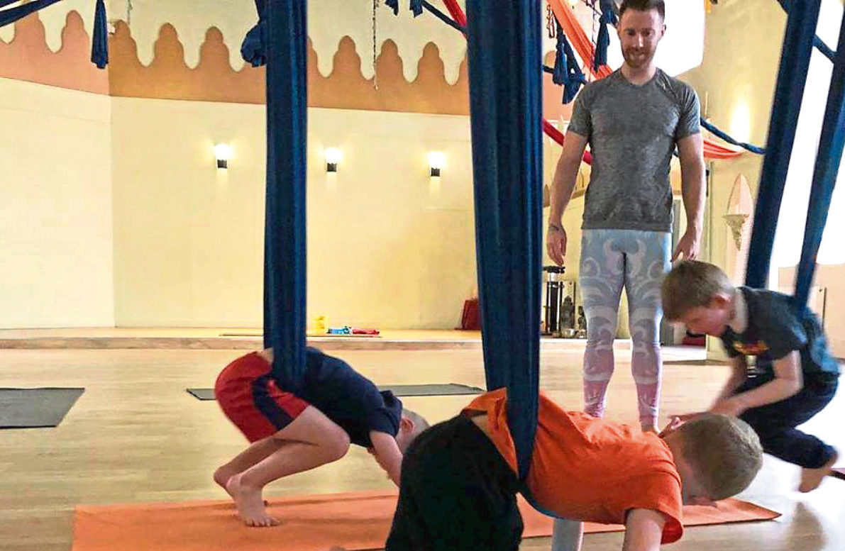 Some of the youngsters are watched over by yoga teacher Finlay Wilson
