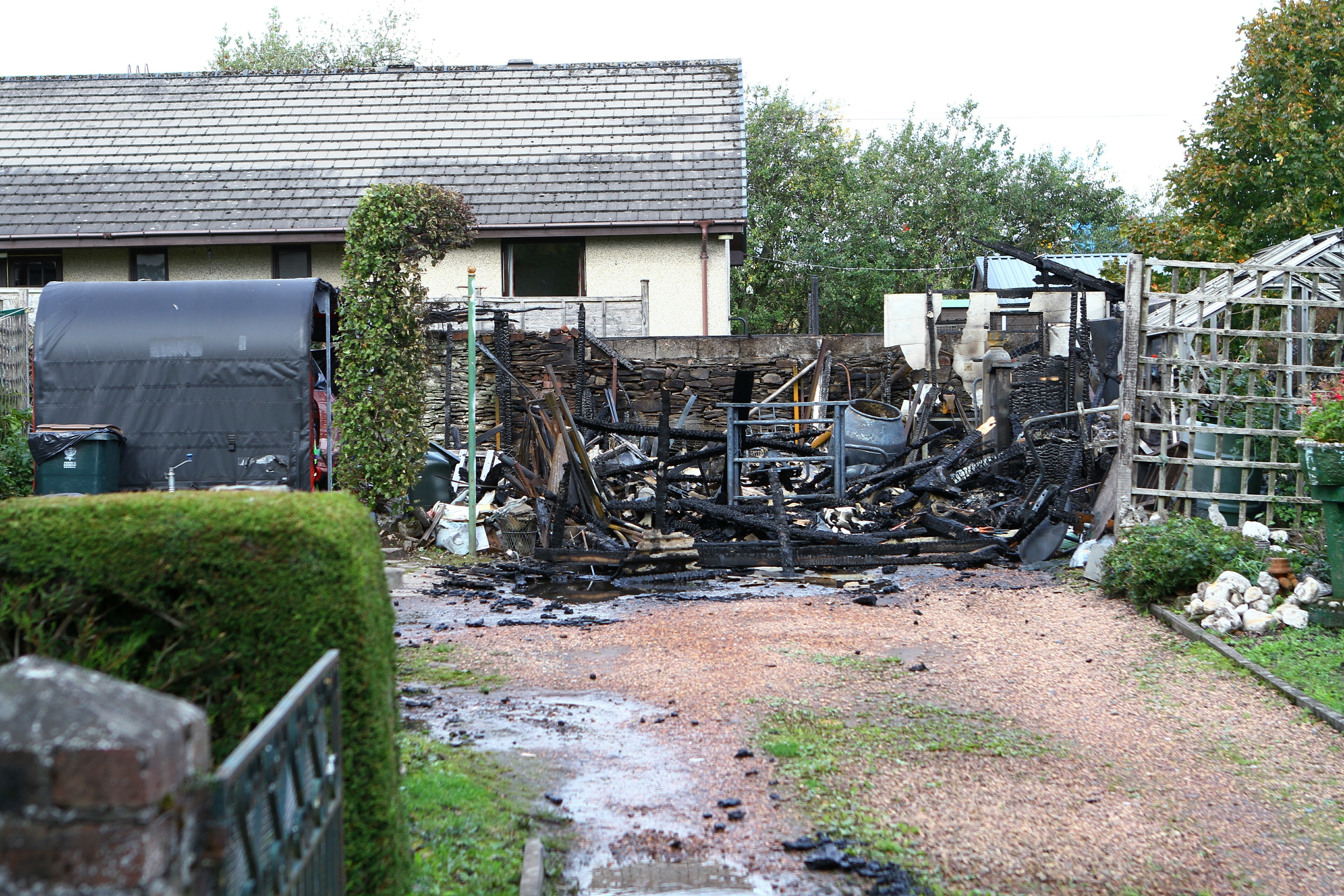 The remains of the garage, containing gas canisters.