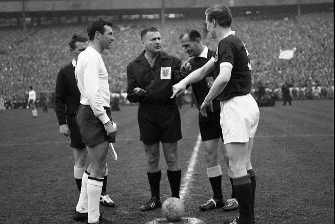 Leo Horn (centre) is the ref for the 1964 Home International between Scotland and England at Hampden. Captains are Jimmy Armfield (England) and Billy McNeill  (Scotland). Alan Gilzean got the goal in the hosts' 1-0 victory