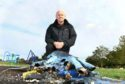 Ron Neave of the community council beside charred remains of the playpark.