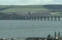 A Coastguard helicopter searches the Tay at Dundee for the man on September 12