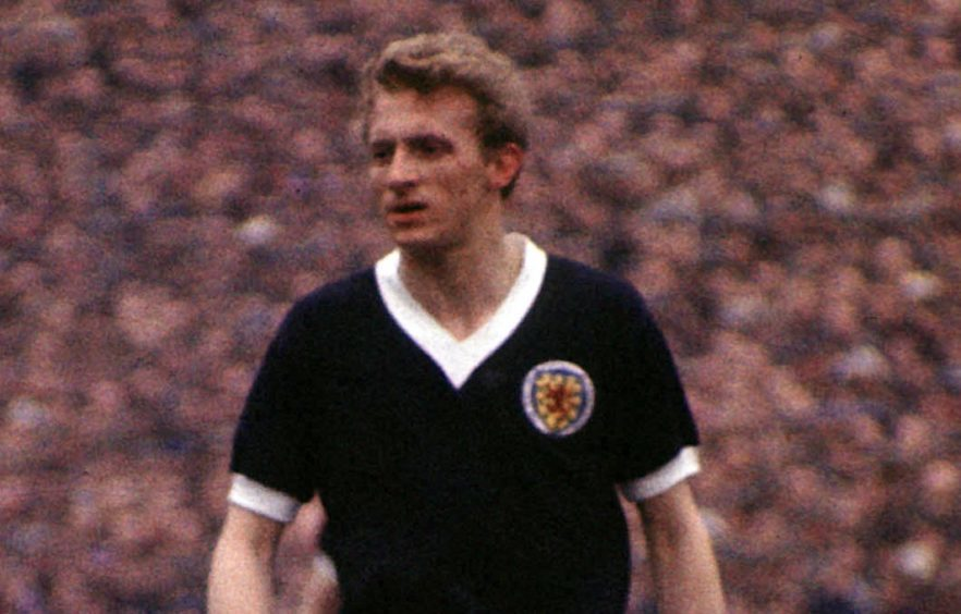Denis Law in action for Scotland in 1964.