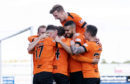 The Dundee United players celebrate Pavol Safranko's goal