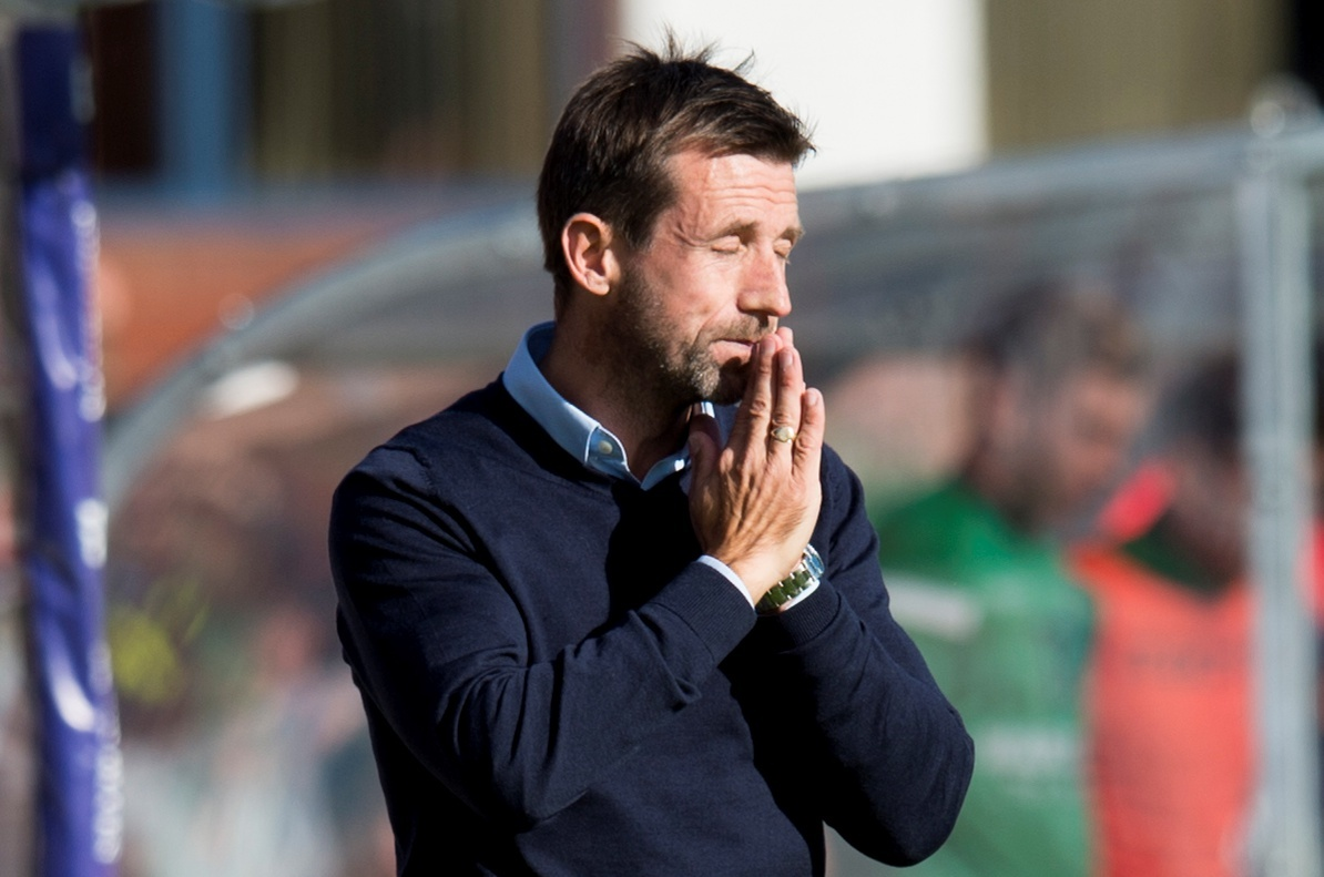 Dundee manager Neil McCann looks dejected on the sidelines as his side suffers a seventh straight defeat