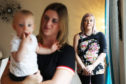 Louise McLuckie, right, suffered a stroke and now can't hold her baby daughter Freyam left being held by auntie Stephanie McEwan