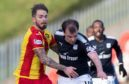 Former Partick man Martin Woods tussles with Dundee's Paul McGowan last season.