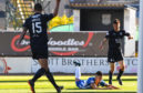 Jordan Jones hits the deck after diving against Dundee. He was later hit with a two-game ban.